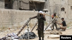Шема -- Асад Башаран эскарна доьхьало ечу Маьршачу Эскаран декъашхой, Димашкъана йистехь, 23Ман2013