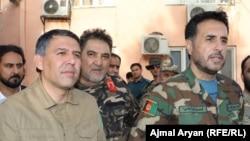 اسدالله خالد سرپرست وزارت دفاع (راست) و مسعود اندرابی سرپرست وزارت داخله افغانستان