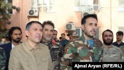 اسدالله خالد (راست) و مسعود اندرابی