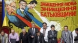 UKRAINE – Ukrainian opposition deputies stand in front of a banner portraying President Viktor Yanukovych, Prime minister Mykola Azarov and minister of education Dmytro Tabachnyk, as they block the speaker's platform. Kyiv, May 25, 2012