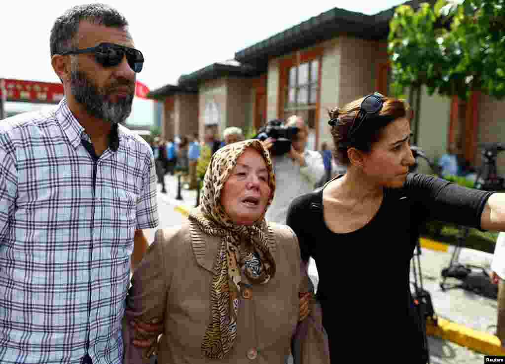 Sacide Bugda (center), mother of Abdulhekim Bugda, who was one of the victims of the attacks, is comforted by relatives at a morgue in Istanbul. (Reuters/Osman Orsal)
