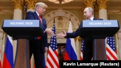 U.S. President Donald Trump (left) and Russian President Vladimir Putin shake hands during a joint news conference after their meeting in Helsinki on July 16.