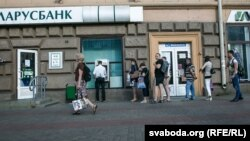 "One bank manager told reporters that ""all the money"" was being withdrawn from ATMs every day. (file photo)"