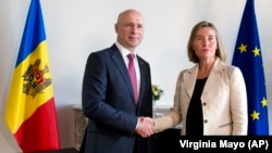 European Union foreign policy chief Federica Mogherini greets Moldovan Prime Minister Pavel Filip prior to their meeting in Brussels on May 3.
