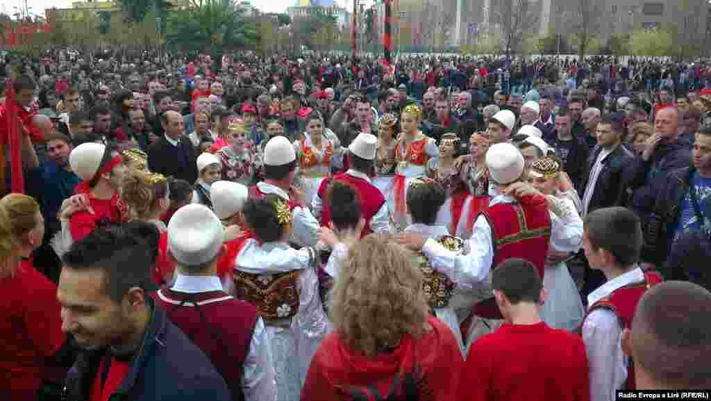 People celebrate in Tirana.
