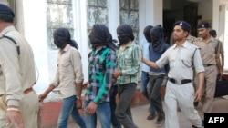 Police officers escort gang-rape suspects to court in Datia, in central Madhya Pradesh state, on March 18.
