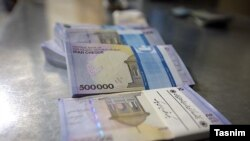 Large denomination Iranian banknotes show the devaluation of the rial. File photo