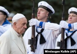 Pope Francis reviews the honor guard during a welcome ceremony at the Kadriorg Presidential Palace in Tallinn on September 25.