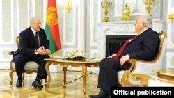 Belarus - President Alexander Lukashenko (L) meets with Armenian Ambassador Armen Khachatrian in Minsk, 28Mar20217.