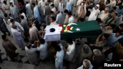 People attend the funeral in Quetta for Pakistani Major Jawad Changezi, who was killed during cross-border fighting with Afghanistan.
