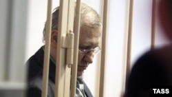 Former Russian lawmaker Mikhail Glushchenko was charged with complicity in the 1998 murder of State Duma deputy Galina Starovoitova.