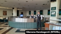 Holiday Hotel staff stand ready in July 2020.