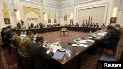 Delegations from Afghanistan, Pakistan, the United States, and China hold a meeting in Kabul on February 23.