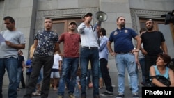 "Armenia - Leaders of the ""Electric Yerevan"" movement address supporters in Yerevan's Liberty Square, 6Jul2015."