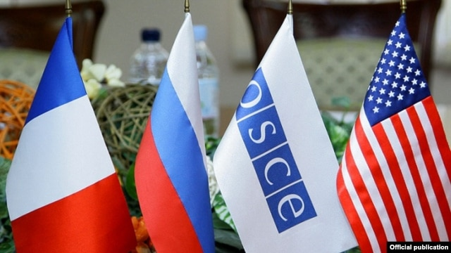 Armenia - Flags of the OSCE and the three nations co-chairing the OSCE's Minsk Group displayed during peace talks in Yerevan, 4Feb2014.