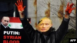 Пікет перад буынкам Рады бясьпекі ААН у Нью-Ёрку супраць падтрымкі Расеяй рэжыму Асада