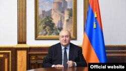 Armenian President Armen Sarkissian clenches his fist as he addresses the nation, calling for unity in the face of the Nagorno-Karabakh war and the coronavirus pandemic, Yerevan, November 6, 2020