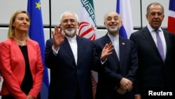 Austria -- Iranian Foreign Minister Mohammad Javad Zarif (2nd L) gestures next to EU foreign policy chief Federica Mogherini (L), Iranian ambassador to IAEA Ali Akbar Salehi (2nd R) and Russian Foreign Minister Sergei Lavrov (R) as they pose for a photo in Vienna, 14Jul2015.