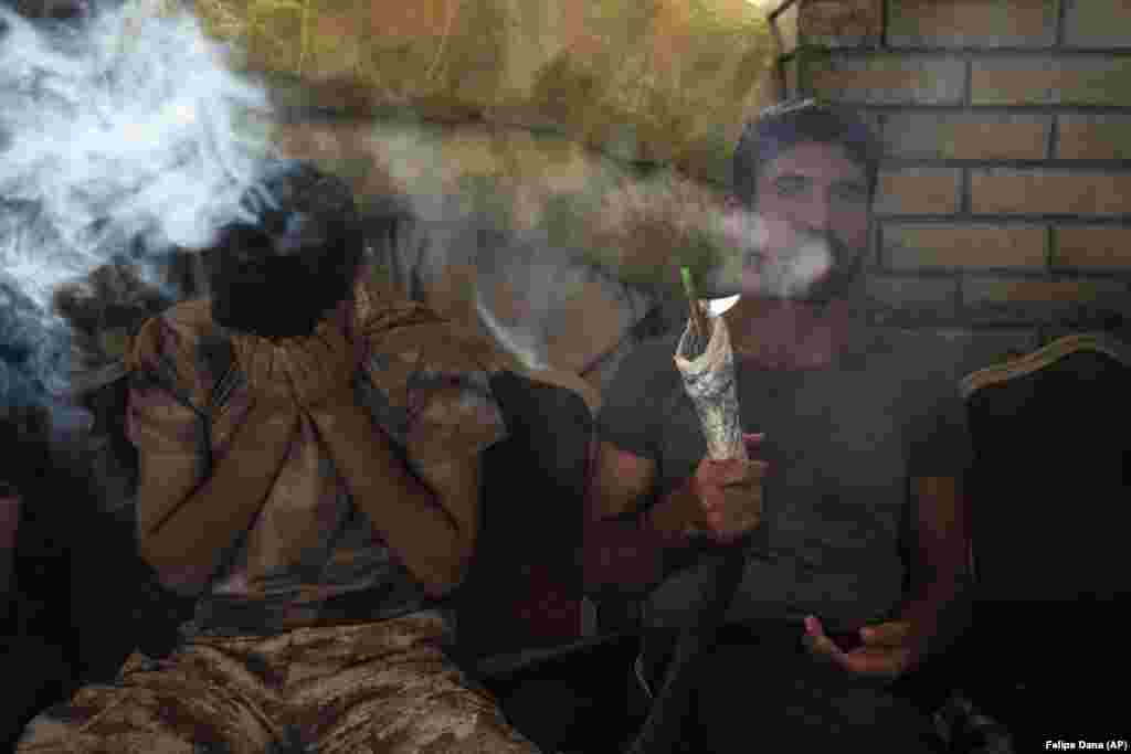 Kurdish men smoke a water pipe in central Irbil, Iraq. (AP/Felipe Dana)