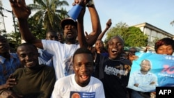 Supporters in Cote d'Ivoire of incumbent Laurent Gbagbo in early December