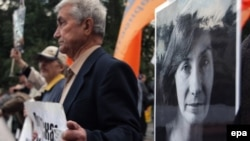 Demonstrators hold portraits of Natalya Estemirova during a rally in Moscow last year.