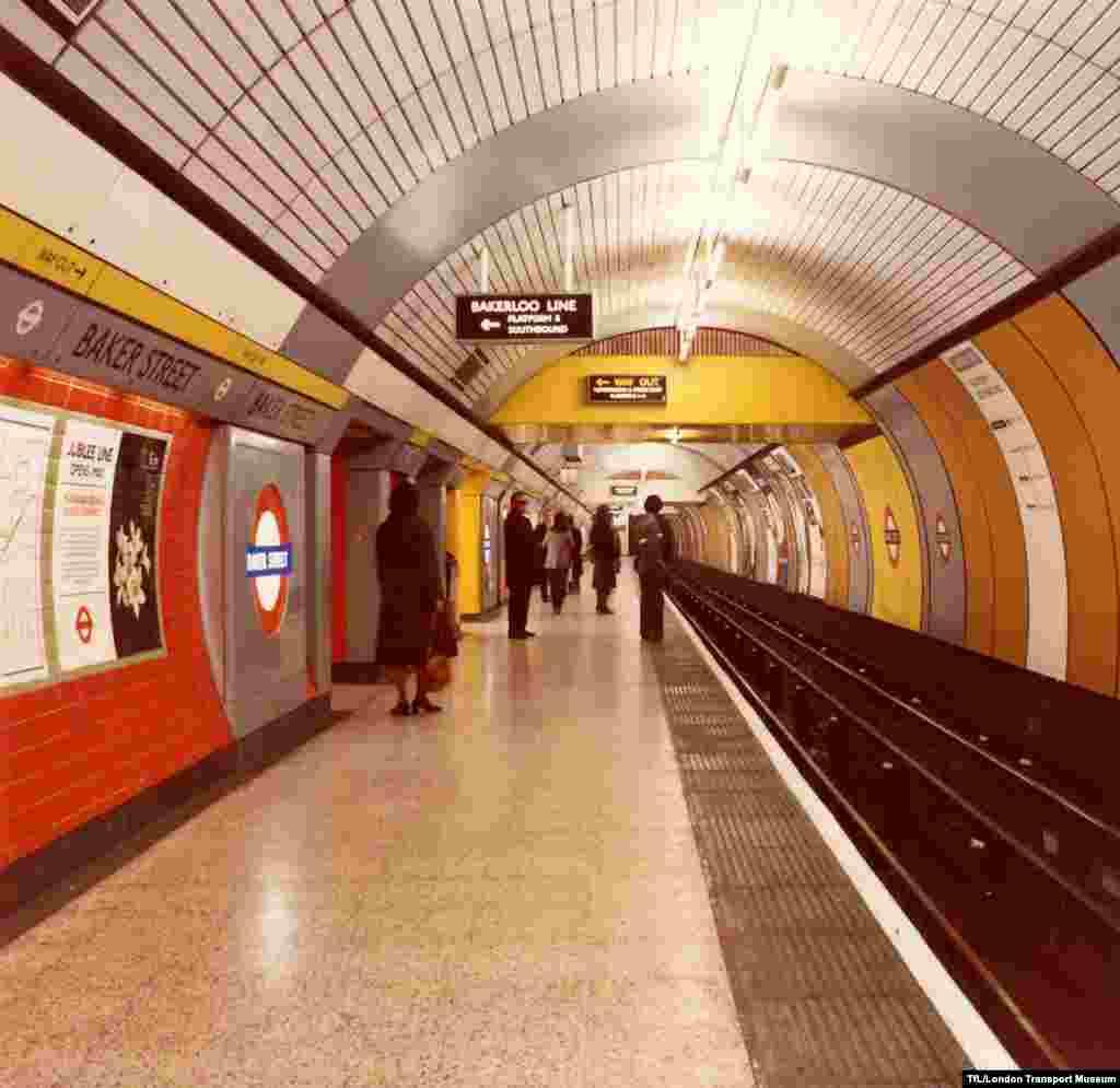 Passengers wait at Baker Street Station.