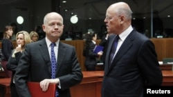 British Foreign Secretary William Hague (left) talks to Dutch Foreign Minister Uri Rosenthal at the start of a EU foreign ministers meeting at the EU Council headquarters in Brussels.
