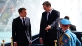 SERBIA -- Serbian President Aleksandar Vucic and French President Emmanuel Macron meet before inspecting an honour guard outside the Serbia Palace building in Belgrade, Serbia, July 15, 2019.