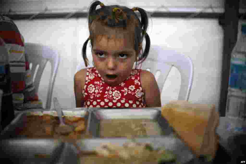 A young Kosovar girl eats her iftar dinner. The holy month ends on the evening of August 7, when Muslims will celebrate Eid al-Fitr.