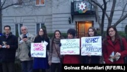 People rally in support of jailed journalist Khadija Ismayilova in front of Azerbaijani Embassy in Washington on December 8.