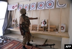 A Pakistani soldier looks at a training center of militants seized in North Waziristan.