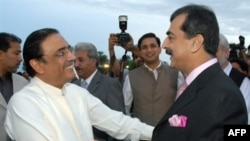 Zardari (left) with Prime Minister Yousaf Raza Gilani after Zardari's election as president