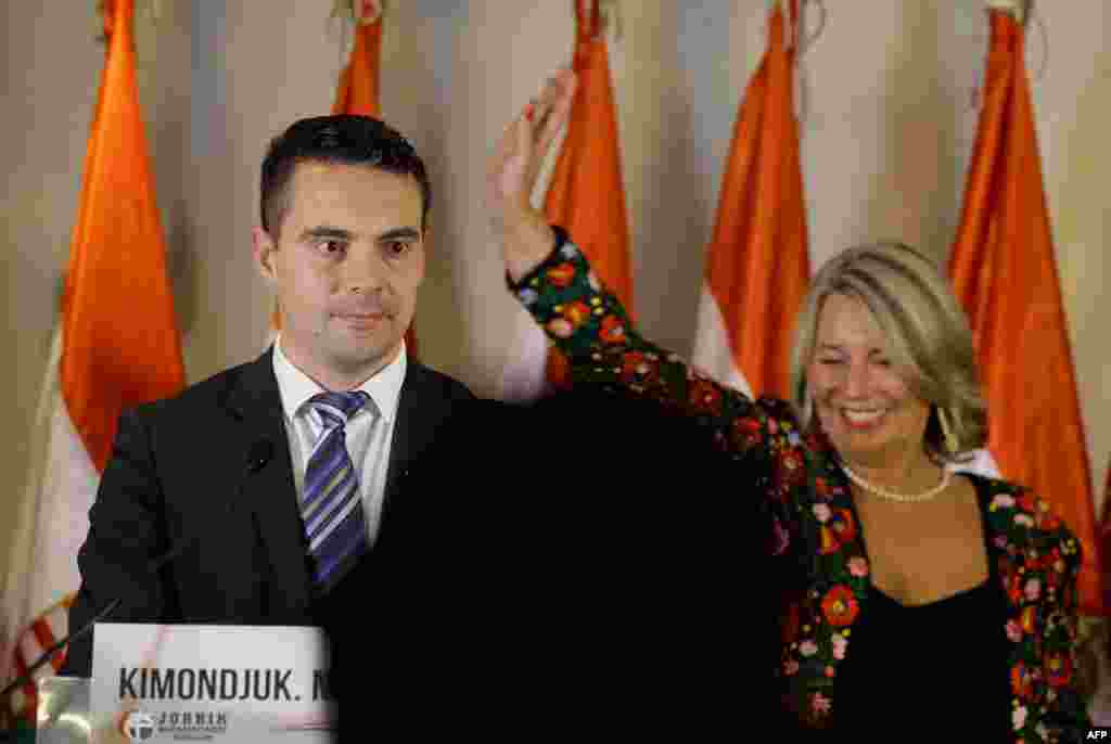 Gabor Vona (left), the chairman of Hungary's far-right Jobbik (Better) party, and party colleague Krisztina Morvay speak in Budapest. The party won some 15 percent of the vote.
