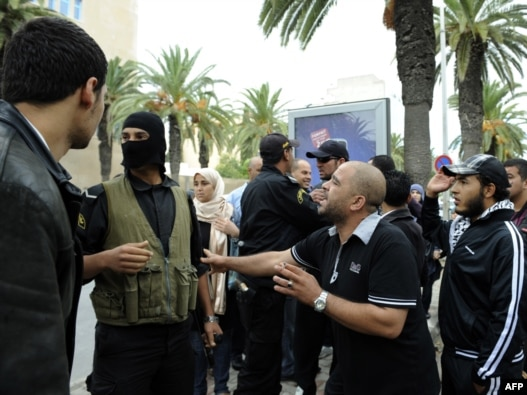 People demonstrate in front of the headquarters of the private TV station Nessma in Tunis on October 9.
