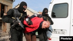 Armenia - Security forces detain a man in a raid on a house in Yerevan's Nork district, 25Nov2015.
