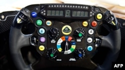 U.K. -- This handout picture received from the Lotus Formula One Team on 28Jan13 shows the steering wheel on the teams newly launched E21 car.
