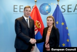 Serbian Prime Minister Aleksandar Vucic with the EU's foreign policy chief, Federica Mogherini. Failure to hand Seselj over to the ICTY may pose an obstacle to Serbia's European-integration ambitions.