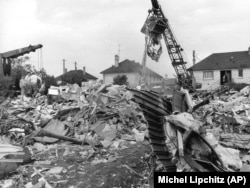 Part of the fuselage of the Tu-144 lies in foreground amid ruins of houses of the village of Goussainville destroyed by debris from the plane crash in 1973.
