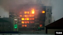 A local media building called the Press House is set ablaze following a gun battle with Chechen insurgents in the regional capital, Grozny, on December 4.
