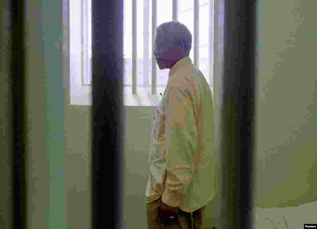 Nelson Mandela stares out of the window of the prison cell he occupied on Robben Island for a large portion of his 27-year incarceration in 1994.