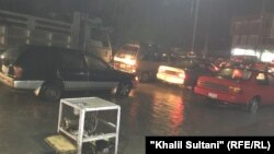 آرشیف/ جاری شدن آب باران به روی سرک ها این تصویر از سرک مکروریان اول شهر کابل است