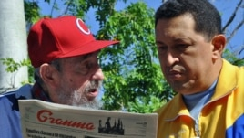 Fidel Castro and Venezuelan President Hugo Chavez (right) in their tracksuits.