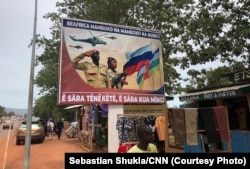 "A billboard in Bangui with the slogan ""The Central African Republic is hand in hand with Russia"" (file photo)"