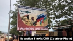 """Posters seen across Bangui, the capital of the Central African Republic, with the slogans, """"The Central African Republic is hand in hand with Russia"""" and """"Talk a little, work a lot."""""""
