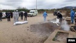 دفن اجساد افرادیکه در اثر ابتلا به ویروس کرونا در ایران جان باخته اند.