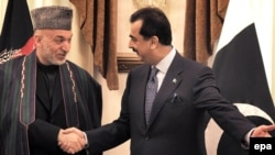 Pakistan's Prime Minister Yousuf Raza Gilani (right) with Afghan President Hamid Karzai in Islamabad in March