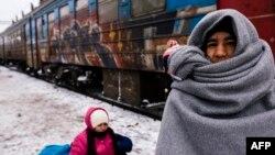 Мигранты во время переправки из Сербии в Хорватию. Прешево, 19 января 2016 года.