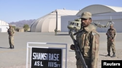 Soldiers guard the Shamsi airfield in Baluchistan Province in a Pakistani handout image from December, when U.S. personnel reportedly were evacuating a remote airfield used for staging drone strikes.