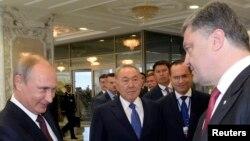 Владимир Путин и Петр Порошенко на встрече в Минске 26 августа 2014 г.