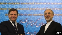 Iranian Foreign Minister Ali Akbar Salehi (right) and Russian Energy Minister Sergei Shmatko shake hands after signing an energy memorandum of understanding in Tehran in September 2011.